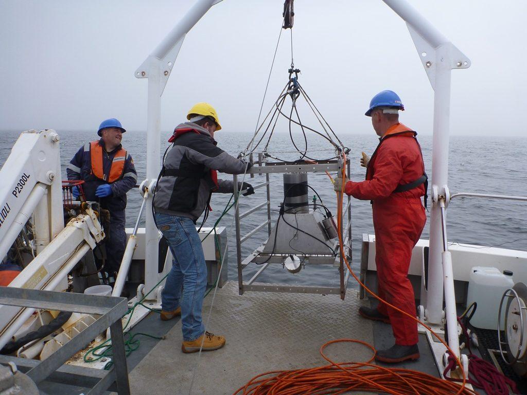 Crew deploying underwater camera system