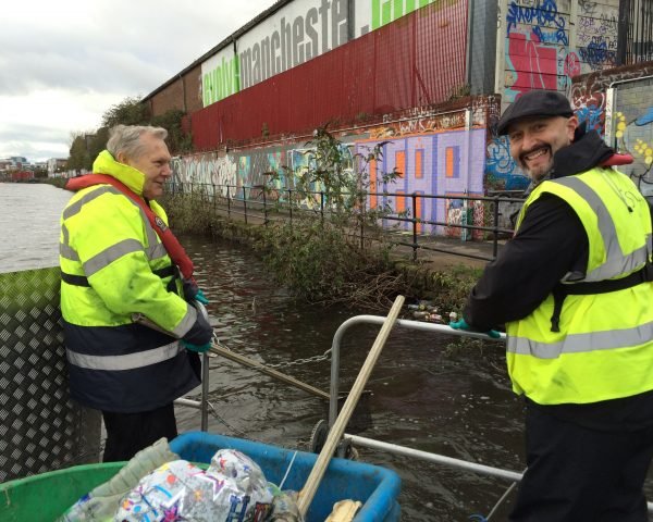 Volunteers from Cargill working on the Irwell Pride litter vessel