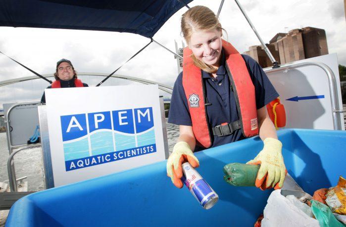 APEM field team scientist going through litter at Salford Quays