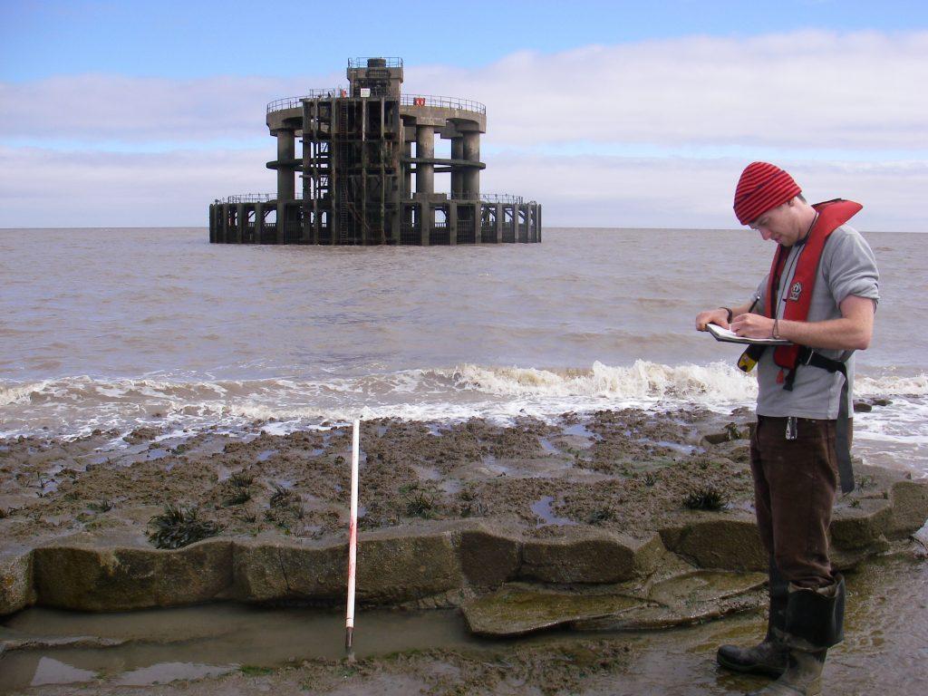 Field team member on a shore survey