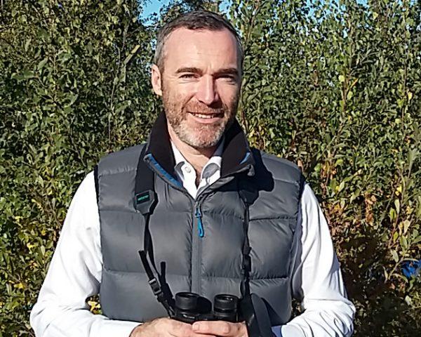 Ornithologist Sean Sweeney with binoculars