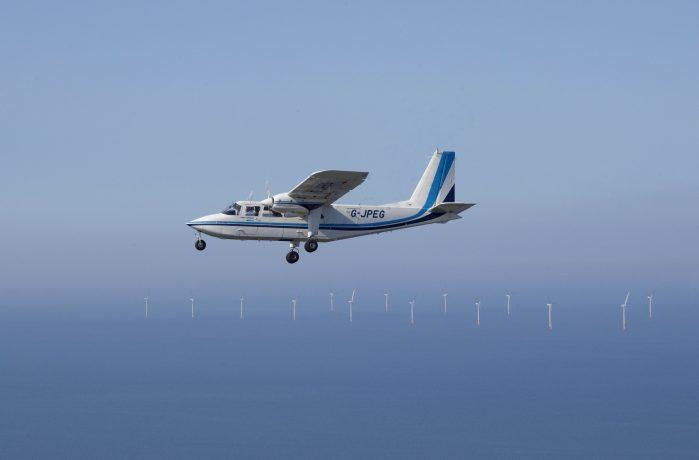 APEM aircraft on aerial survey over a wind farm