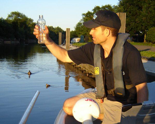 Scientist gathering water samples