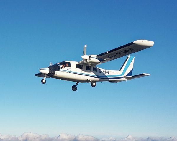 Survey aircraft in flight, blue sky