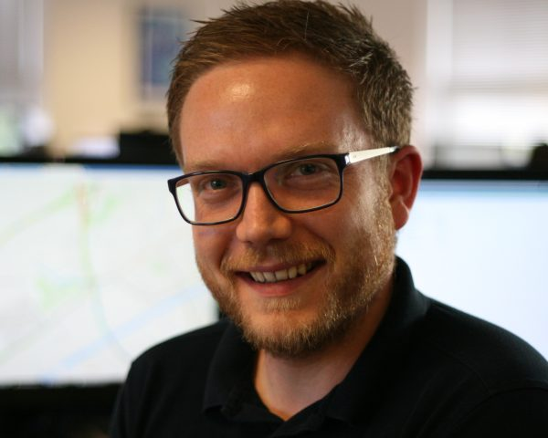 Mark Jowett, remote sensing scientist, at his computer