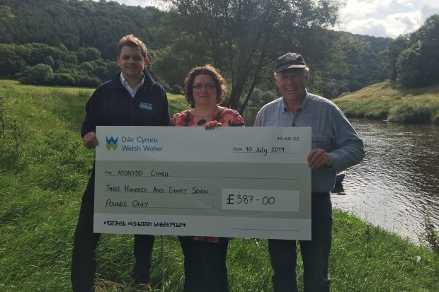 APEM and Welsh Water hand over cheque to Afonydd Cymru